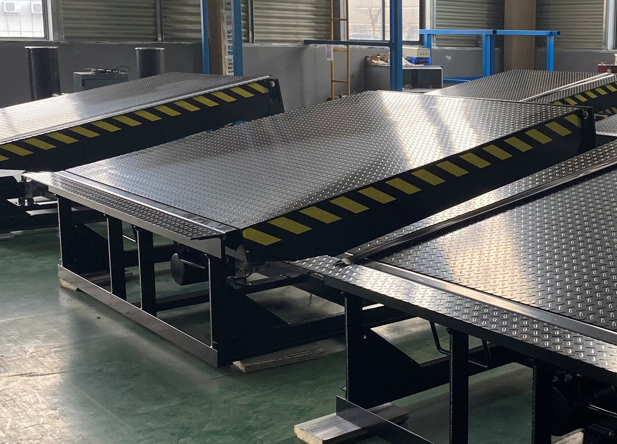 What is a loading dock leveler?
